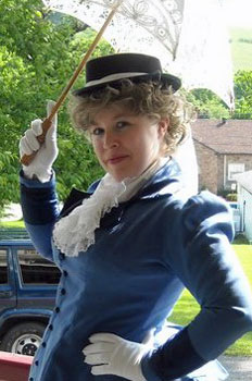 Museum Docent Rachel giving historical tours in Victorian wig